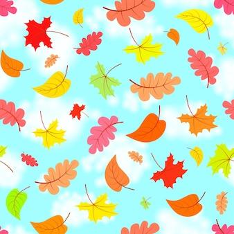 青い空を横切る落ち葉、カラフルなシームレスパターン