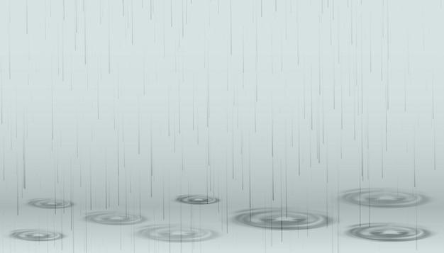 降る雨が波紋とともに地面に落ちる