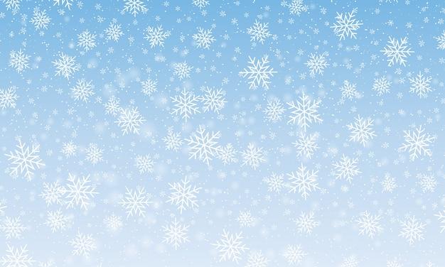 雪の降る雪。冬の青い空。クリスマスのテクスチャです。輝きの雪の背景。
