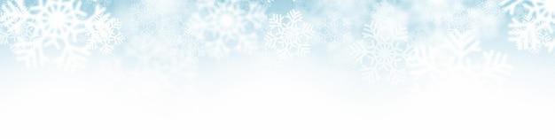 降る雪片クリスマスデコレーションライトホワイトブルー抽象的なバナー