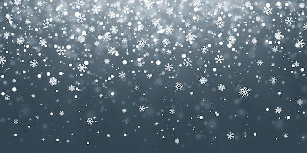 Падающие снежинки на синем фоне. снегопад