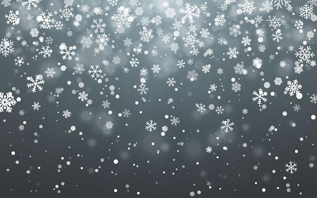 Падающие снежинки на темном фоне