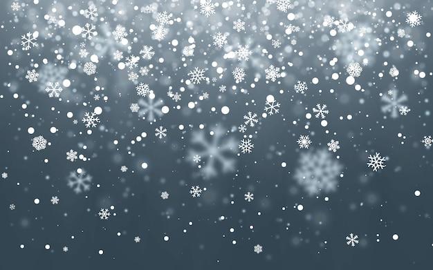 暗い背景に降る雪