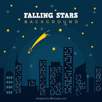 Falling star over a night city