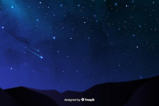 Падающие звезды на фоне красивой ночи