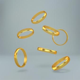 落下する結婚式の金の指輪