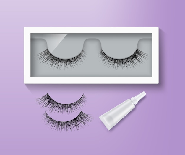 False eyelashes in packaging and glue tube. pair of black long lashes on purple background