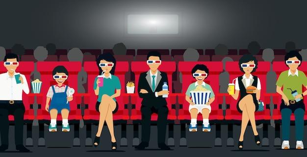 家族は映画館で食べ物や飲み物を持って映画館に座っています