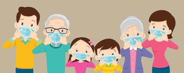코로나 바이러스에 대한 보호 의료 마스크를 착용하는 가족 및 조부모