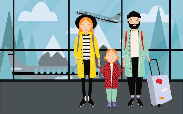 空港での家族。赤ちゃんと荷物を持つトレンディな若いカップル。