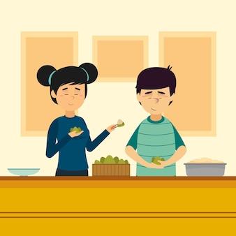 집에서 가족을 준비하고 zongzi를 먹는