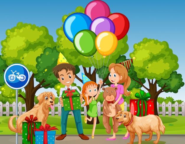 Family celebrate birthday at the park