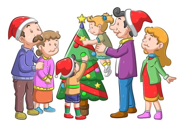 家族はリボンとランプでクリスマスツリーを飾ります