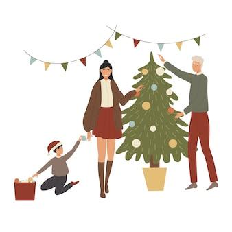 新年のクリスマスツリーを飾る家族