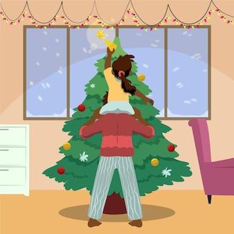 함께 크리스마스 트리를 장식하는 가족