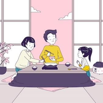 Famiglia che mangia in una casa tradizionale