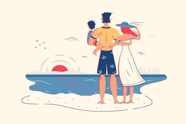 Семья наслаждается видом на океан на пляже