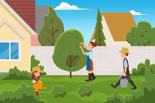 Семья собирает фрукты на заднем дворе дома.