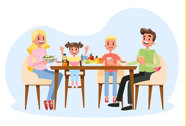 台所のテーブルで朝食を持っている家族。幸せな両親