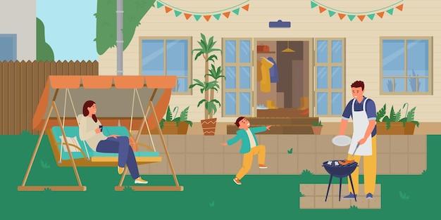 裏庭でグリルパーティーをしている家族