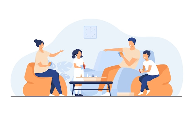 Family home activities concept. happy boy and girl with parents playing board games with cards and dices in living room. for entertainment, togetherness, having together topics