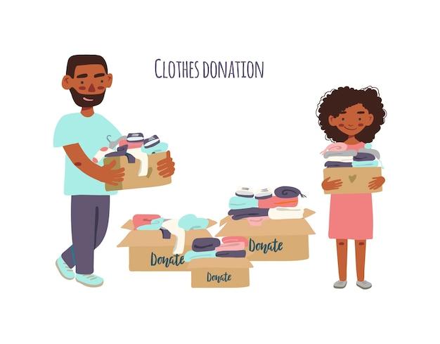 寄付やリサイクルのために、衣類の入った段ボール箱を持っている家族やボランティア。