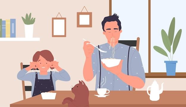 家族は朝食の子供と猫を食べるテーブルに座ってキッチンのインテリアで遊ぶ