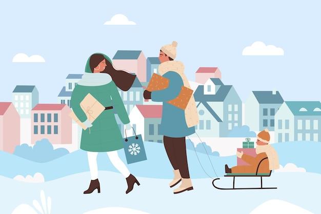 Семейные люди родители гуляют в городском рождественском зимнем городском пейзаже