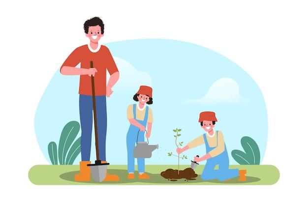 野外活動で木を育てる家族。