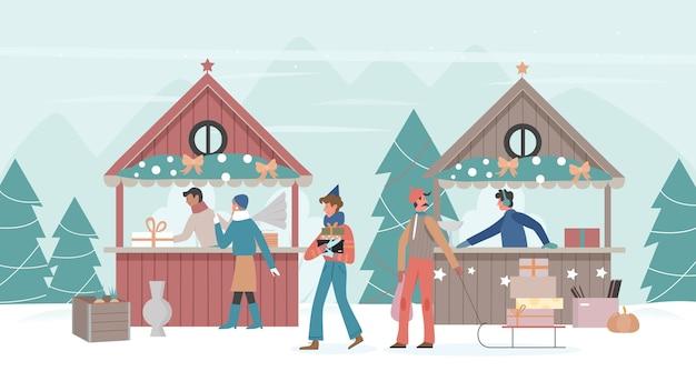 家族はクリスマスの街や村の市場を歩く