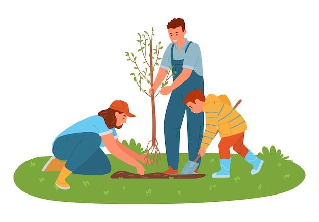 Семья сажает дерево на открытом воздухе