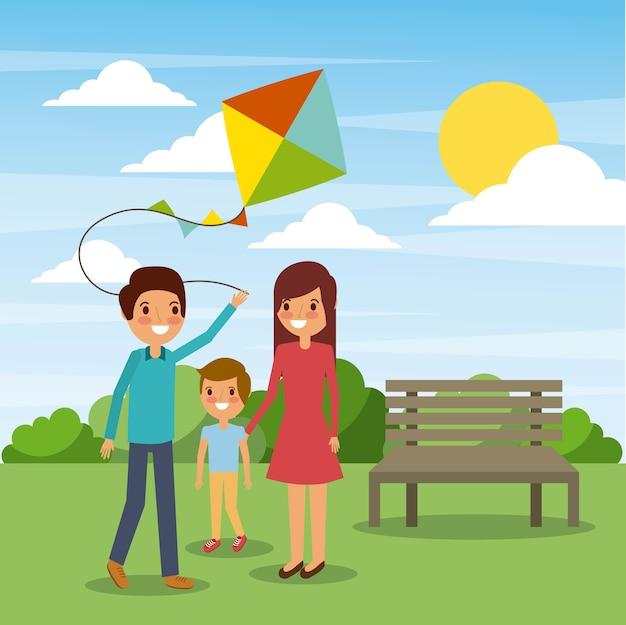公園で面白いカイトと家族の遊び