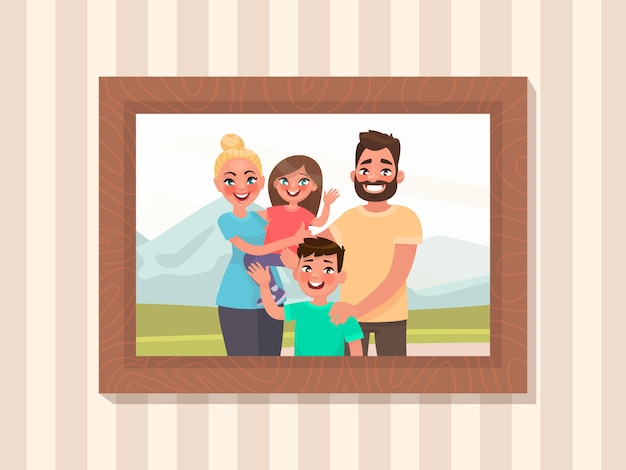 Family portrait in a frame on the wall. photo for memory. mom dad and children on the background of nature