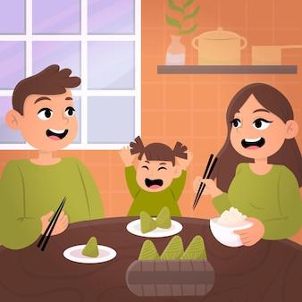 Семья готовит и ест цзунцзы