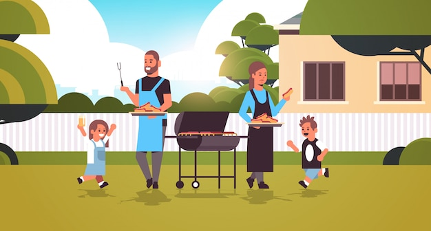 Family preparing hot dogs on grill happy parents and children having fun backyard picnic barbecue party concept flat full length horizontal