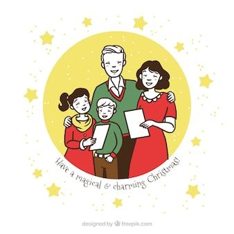 Family singing a christmas carol Free Vector