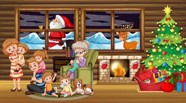 Family sitting around christmas tree