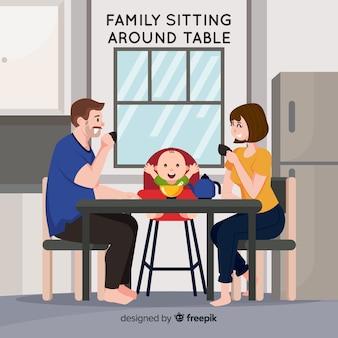 테이블 주위에 앉아있는 가족