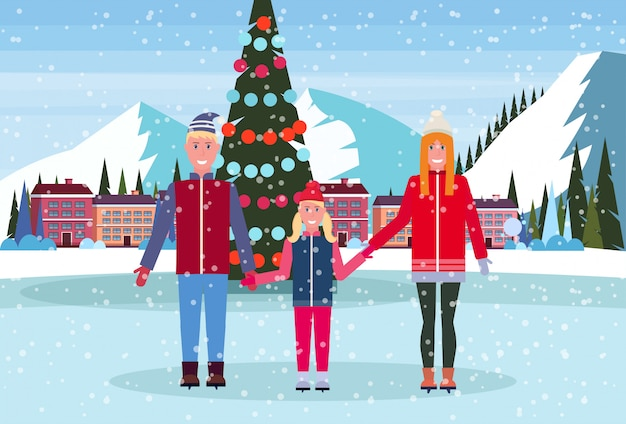 Family skating in ice rink with decorated christmas tree at ski resort hotel
