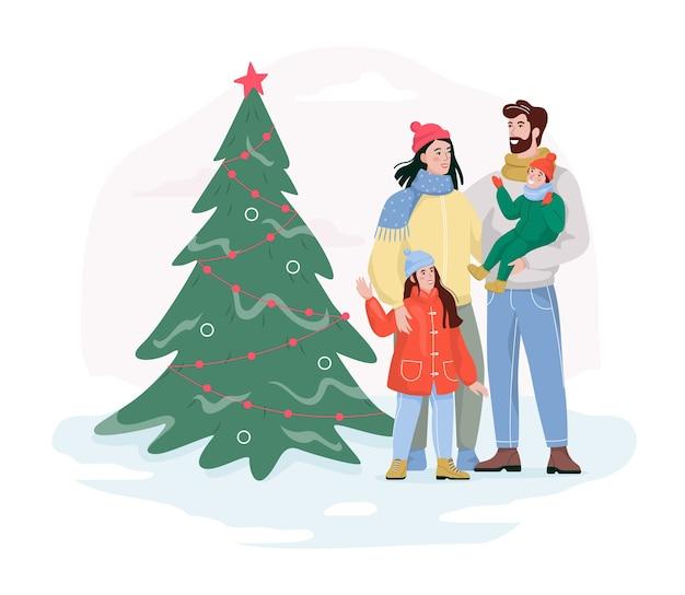 家族はクリスマスツリーで路上に立っています。伝統的な休日