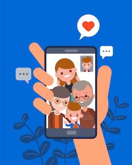 가족과 함께 그림. 스마트 폰 화상 통화 앱을 사용하여 가족과 채팅하는 사람. 인간의 손을 잡고 스마트 폰 장치. 평면 디자인 만화 캐릭터.