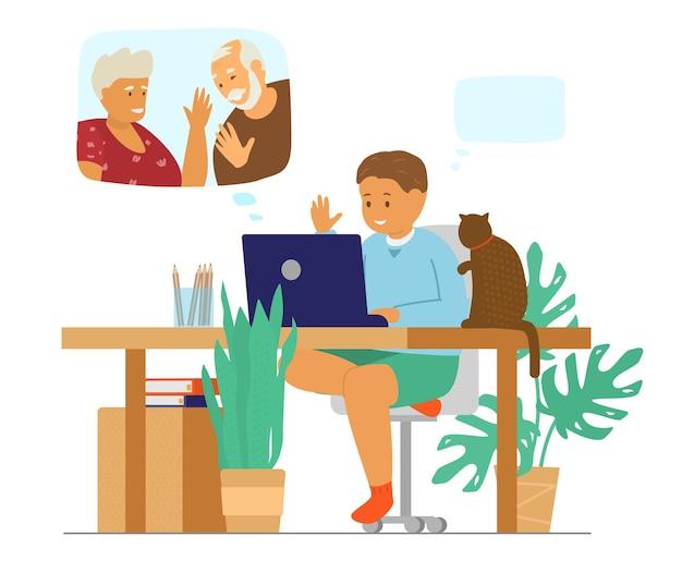 가족 화상 회의. 화상 통화로 조부모에게 이야기하는 노트북 앞에서 고양이와 함께 앉아있는 아이.