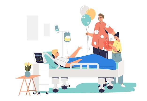 Семья навещает пациента в больнице