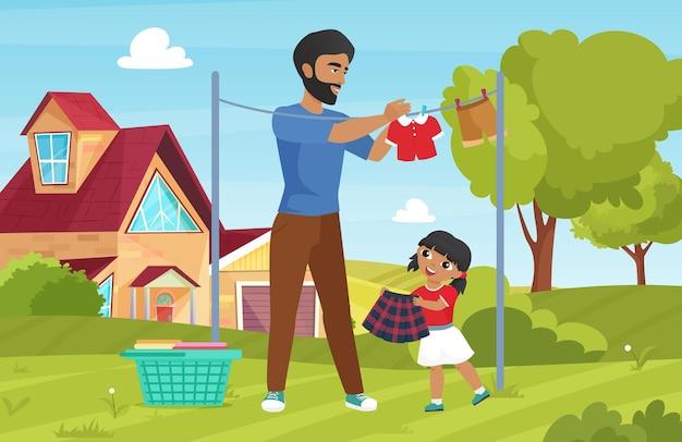 Семья стирает одежду по дому с молодым отцом и дочерью