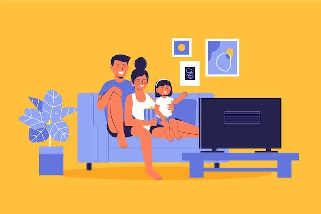 家で映画を見ている家族