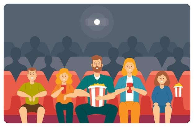 Семья смотрит фильм в кино. молодая мать, отец, дочь и сын с кукурузой смотрят фильм в кинотеатре