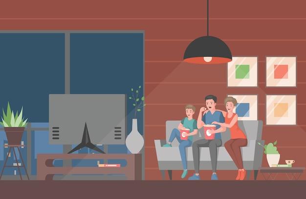 テレビで映画やテレビ番組を見ている家族