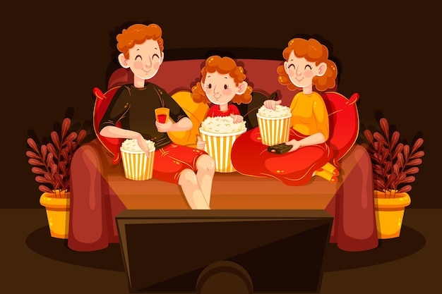 Family watching a movie on their sofa