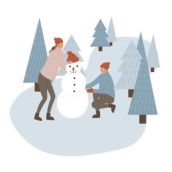 一緒に家族の冬のクリスマス休暇。子供と雪だるまを作る降雪のウィンターパークの家族。
