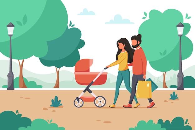 공원에서 산책하는 유모차와 가족